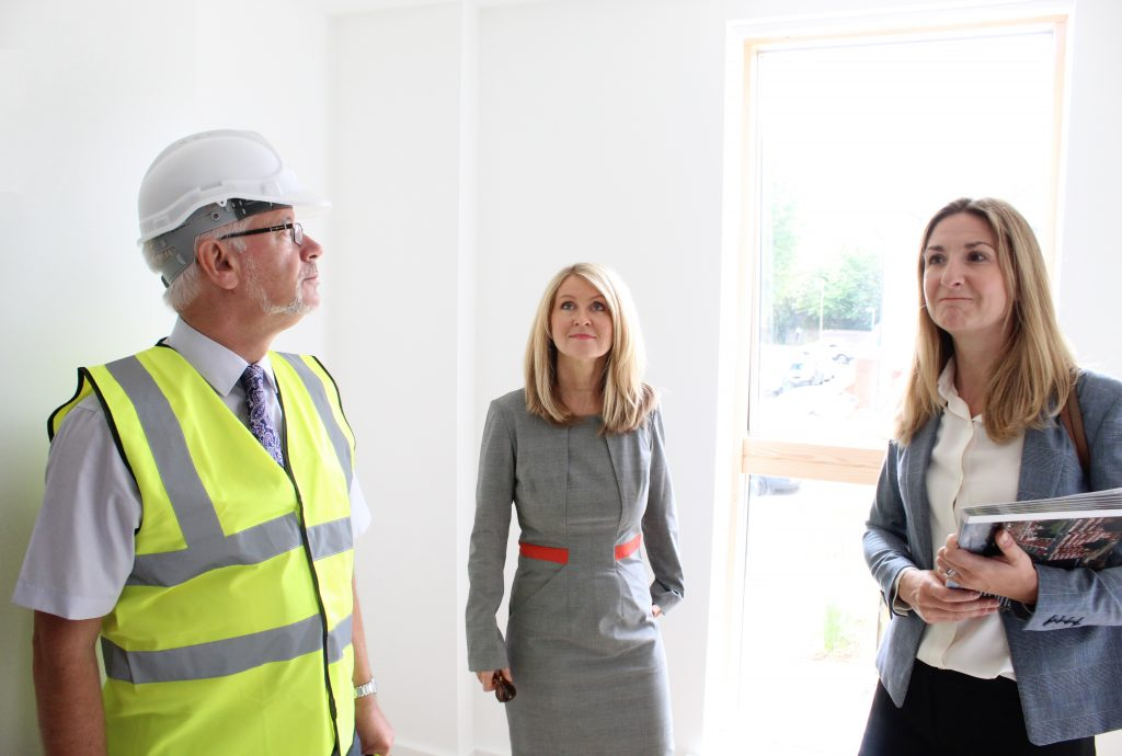 Brendan Reynolds Glenman Corporation, Housing Minister Esther McVey and Wandsworth Housing Councillor Kim Caddy, at Edward Foster Court in Battersea to celebrate 100 years of social housing.